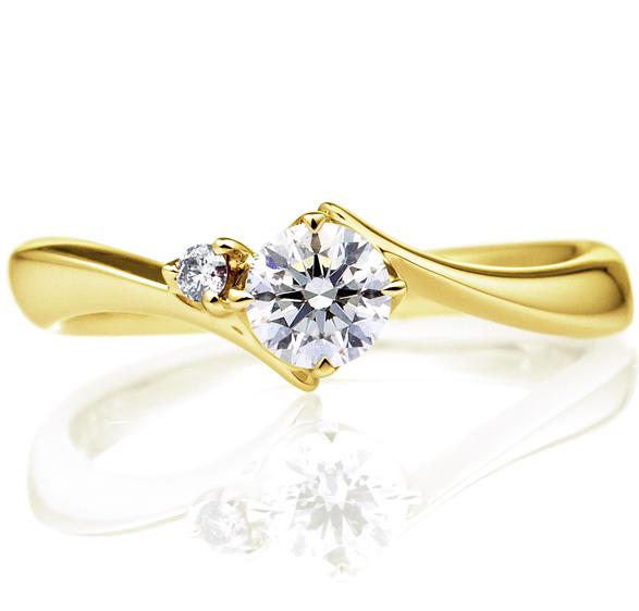 洗練された美しさを持つイエローゴールドの婚約指輪の画像